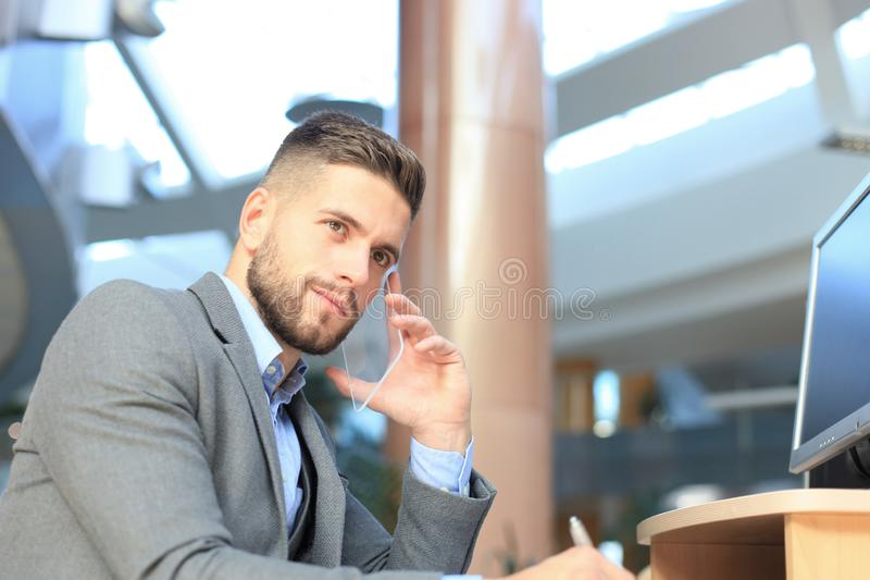Transparent phones of the future concept, a Caucasian businessman having call with his friend.  royalty free stock photos