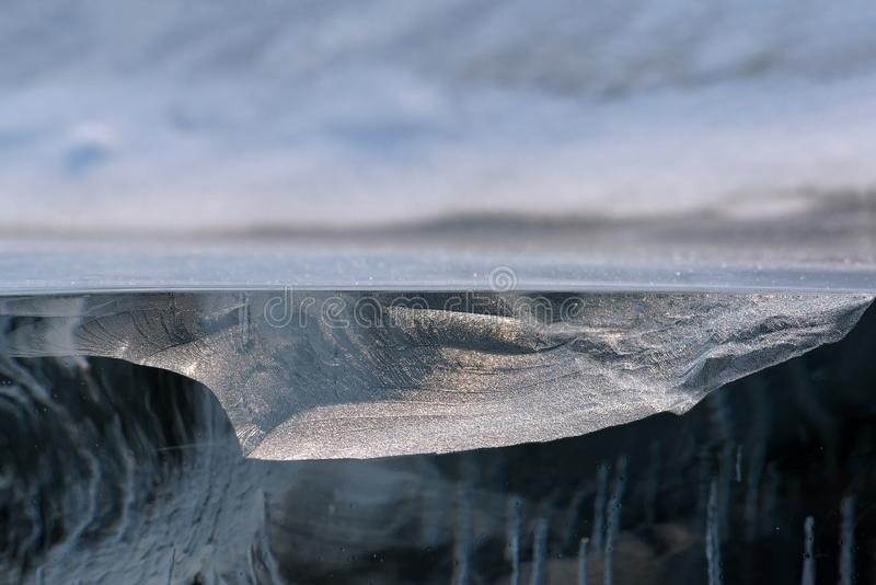 Transparent piece of ice like geological cross-section of Baikal lake royalty free stock photo