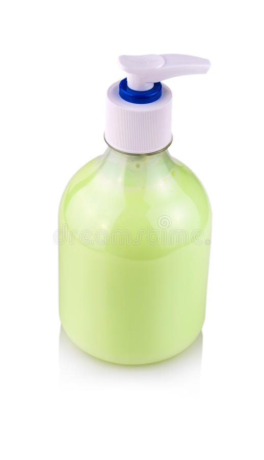 Transparent plastic bottle with green liquid hand soap. Transparent plastic bottle with green liquid hand soap and white dispenser lid, isolated on white stock photo