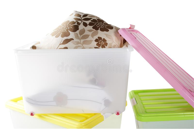 Transparent plastic box with tow cushions. The background of the picture is white. There are three transparent plastic boxes in the picture. The colors of the royalty free stock photos