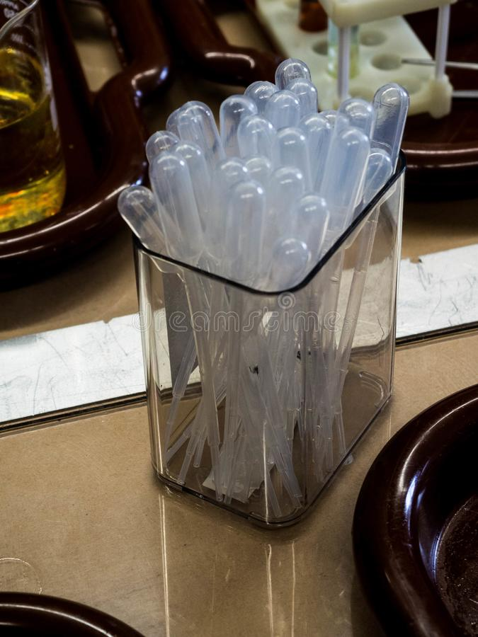 Transparent plastic pipettes in a box in the laboratory stock photography