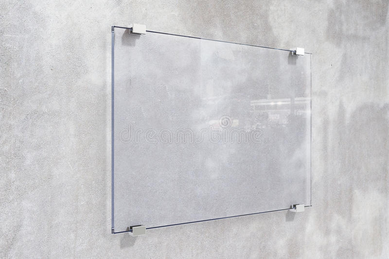 Transparent signboard on concrete wall. Mock up royalty free stock image