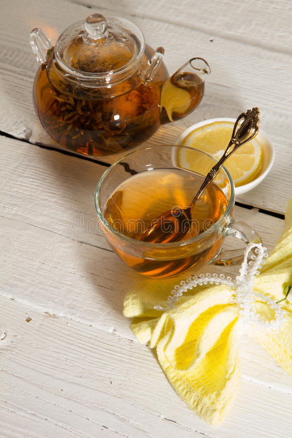 Transparent teapot and cup of tea royalty free stock photo