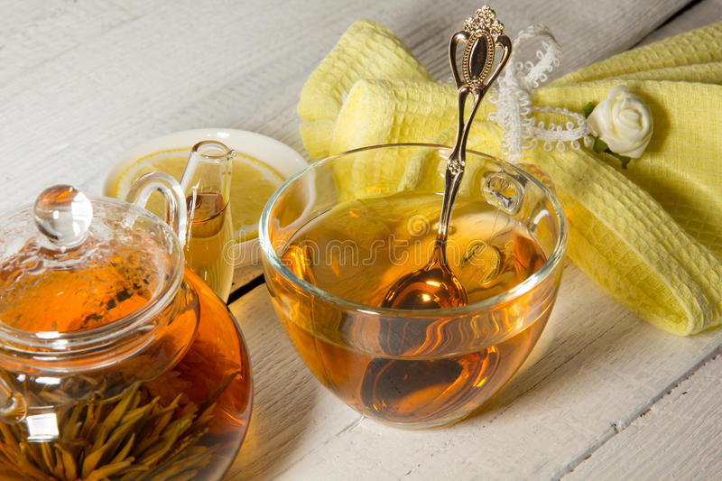 Transparent teapot and cup of tea royalty free stock image