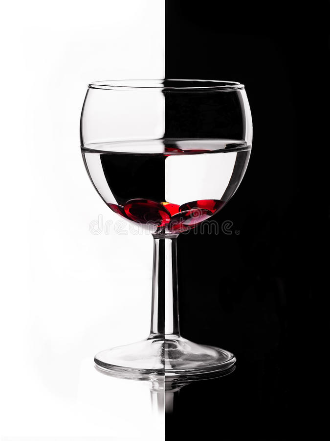 Transparent wineglass with red marble royalty free stock images