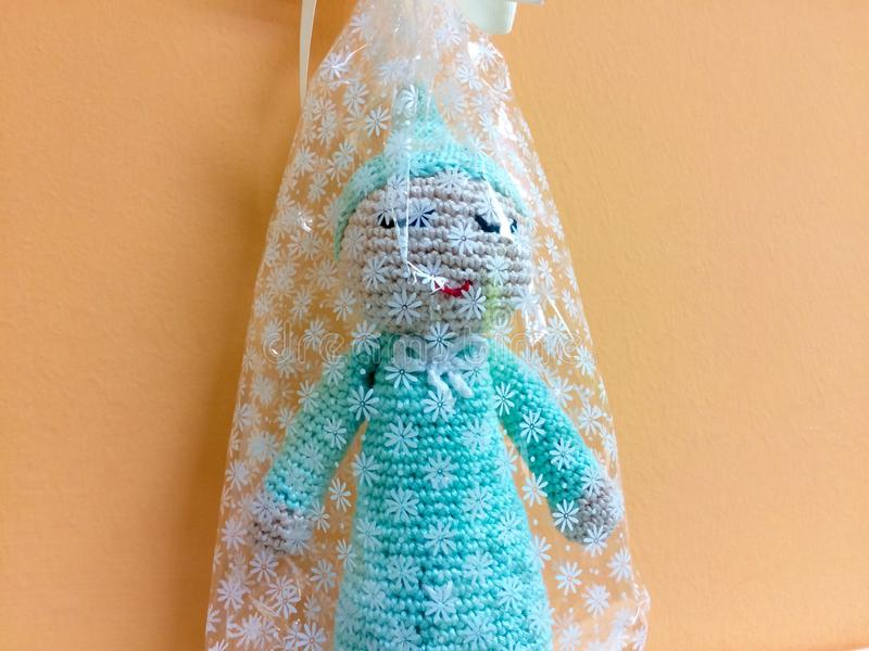 Turquoise blue plush amigurumi gift stock photo