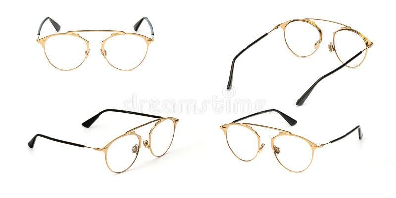 Transparente determinado del material del metal del oro de los vidrios aislado en el fondo blanco Vidrios del ojo de la oficina d fotografía de archivo libre de regalías