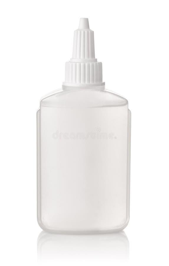 Transparente Plastikkleberflasche lizenzfreie stockbilder