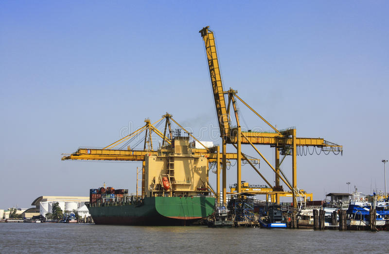 Transport container ship dock on chao phraya river. For transportation stock photo