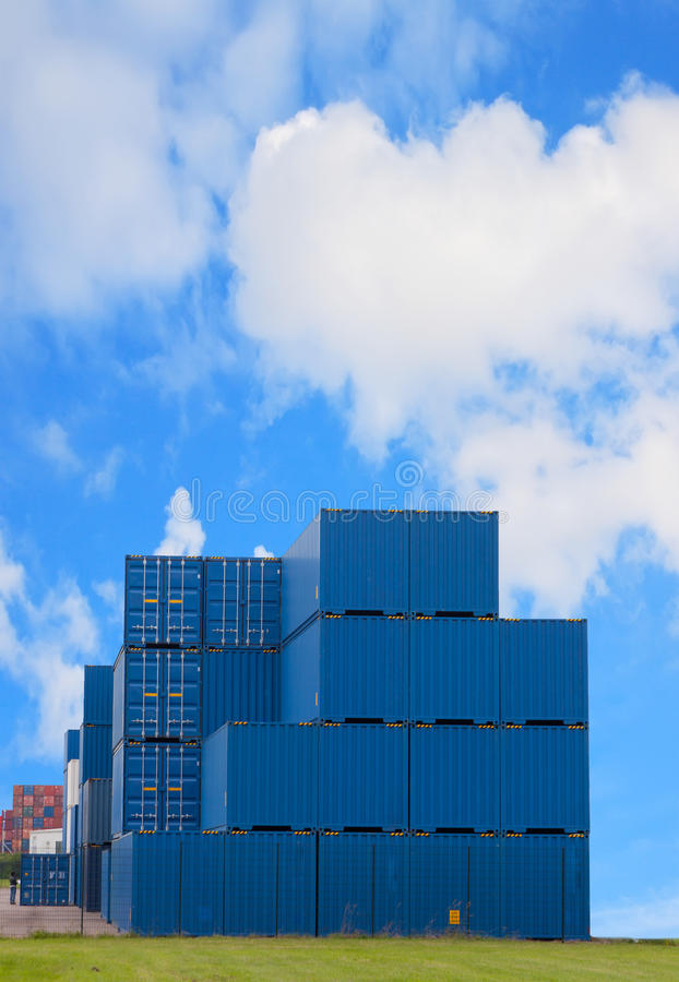 Transport containers. Stand on a grass against the blue sky royalty free stock photos