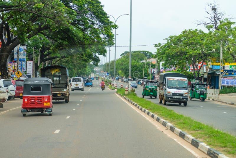 Transport on Kandy - Jaffna highway road in Dambulla town area. DAMBULLA, SRI LANKA - NOV 2016: Transport on Kandy - Jaffna highway road in Dambulla town area royalty free stock image