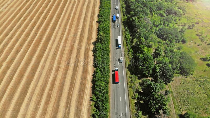 Transport logistic background. Trucks and cars on a highway. stock images