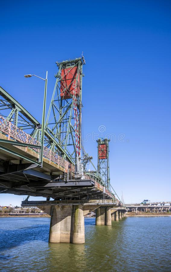 The transport and pedestrian truss Hawthorne bridge with two towers across the Willamette River in the center of Portland Oregon. Sectional Arched Metal truss royalty free stock images