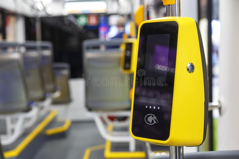 Transport POS-terminal. Payment for travel in transport. Validator for applying the ticket. Non-cash transport payment. Contactless travel payment by credit royalty free stock photo