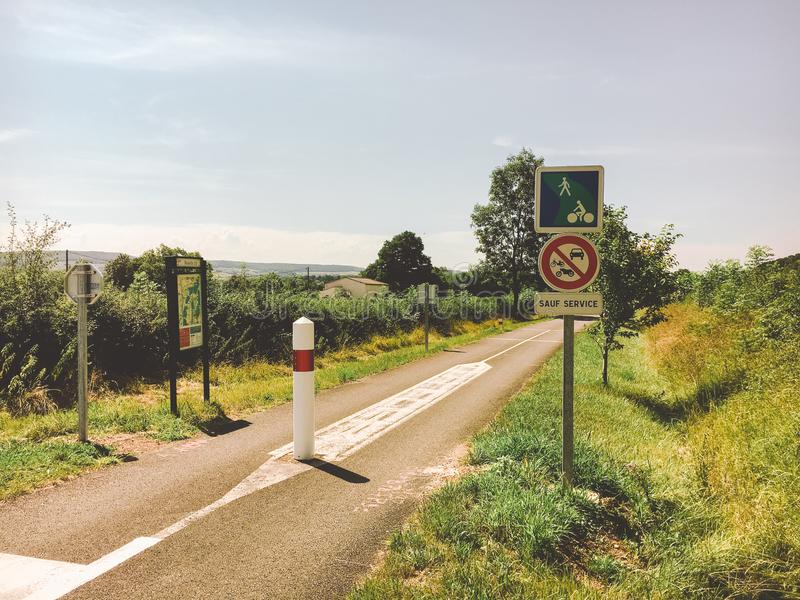 Transport and roads in the france region of the burgundy. Bicycle route, service road in rural areas in summer. Road signs and war royalty free stock image