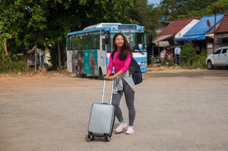Asian young cheerful woman traveling by bus . stock photos