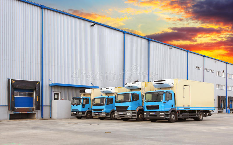 Transport Trucks Docking in warehouse. Truck at a warehouse building royalty free stock photos