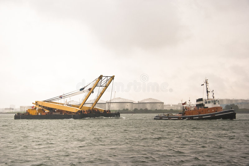 Transport with tug. Sailing on the river stock photography