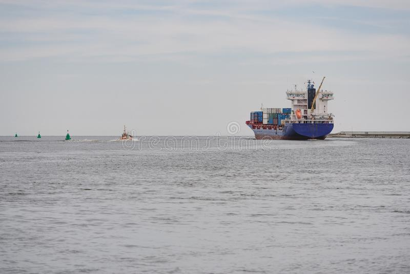 Transport vessels depart from the port to the open Baltic Sea royalty free stock images
