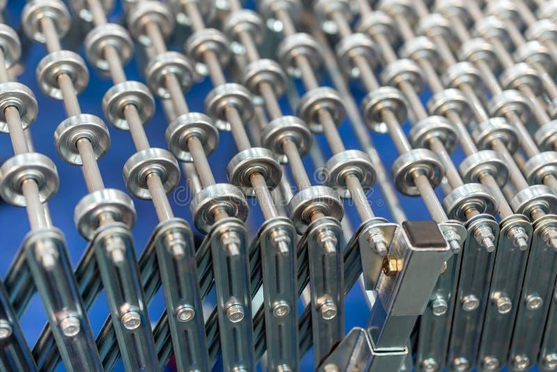 Transportador de rodillo ajustable flexible Tecnología del transporte del producto innovador de Poratable para la fábrica y logís imagen de archivo libre de regalías