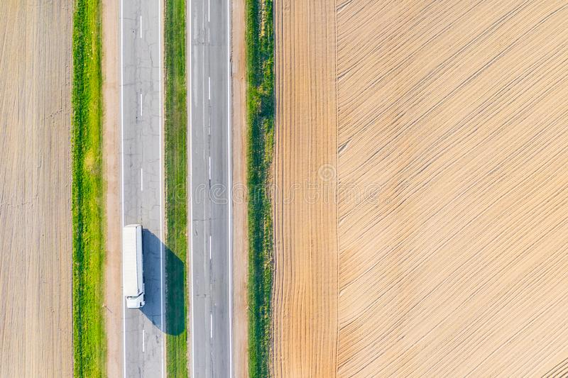 Transportation along dry farmlands, aerial landscape. Crops concept. Nature problems in summer royalty free stock image