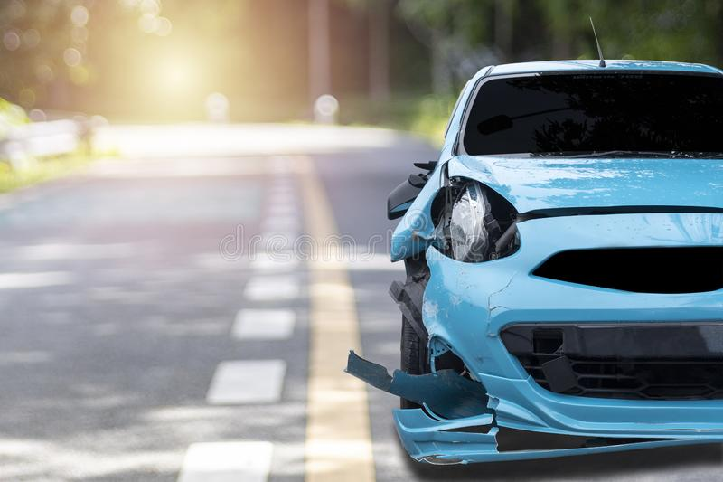 Front of blue color car big damaged and broken by accident on city street parking can not drive any more. With copy space for text. Transportation concept. Front royalty free stock images