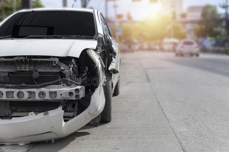 Front of white color car big damaged and broken by accident on city street parking can not drive any more. With copy space for. Transportation concept. Front of royalty free stock photography