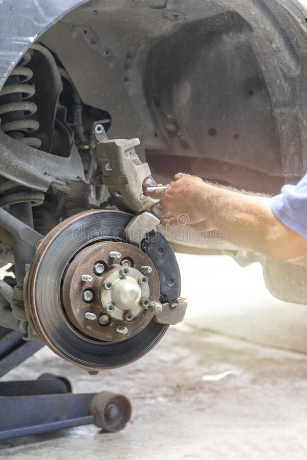 Hand mechanic repair brake disc. Change new break pad. Motion focus and focus to disc break. Transportation concept. Hand mechanic repair brake disc. Change new stock image