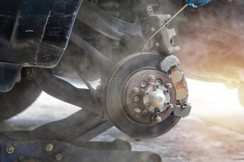 Mechanic use air gun clean disc break take dust removes before change break pat. Transportation concept. Mechanic use air gun clean disc break take dust removes stock image