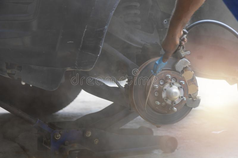 Mechanic use air gun clean disc break take dust removes before change break pat royalty free stock photos
