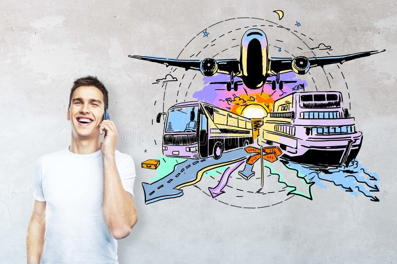 Transportation concept. Smiling guy talking on phone on concrete background with creative bus, ship and plane sketch. Transportation concept royalty free stock photos