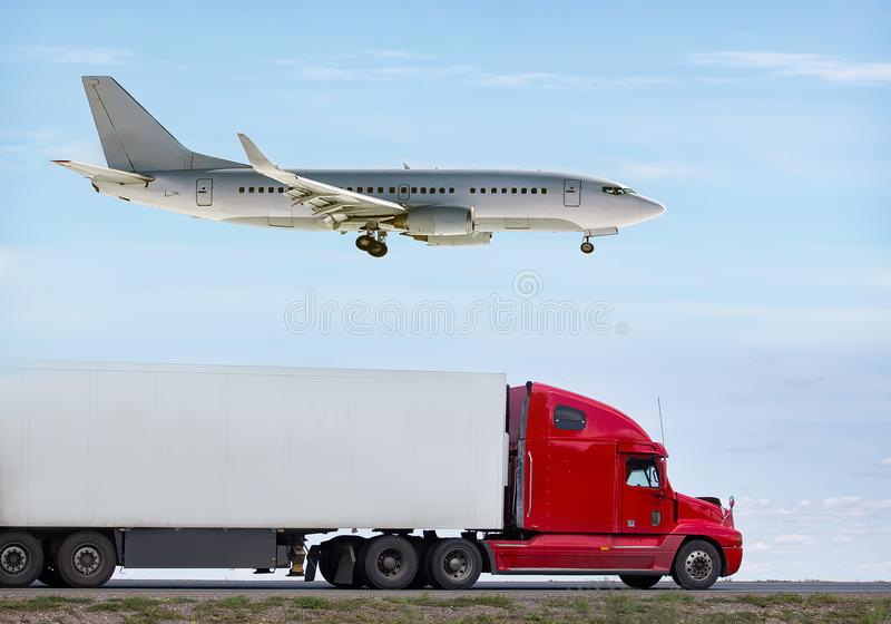 Transportation, import-export and supply concept. Truck and airplane cargo and goods delivery stock photography