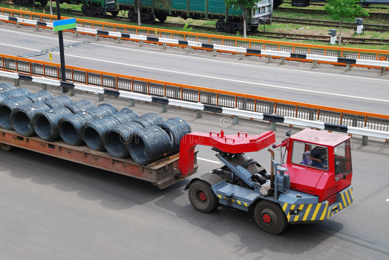 Transportation of metal wire. On road royalty free stock photo
