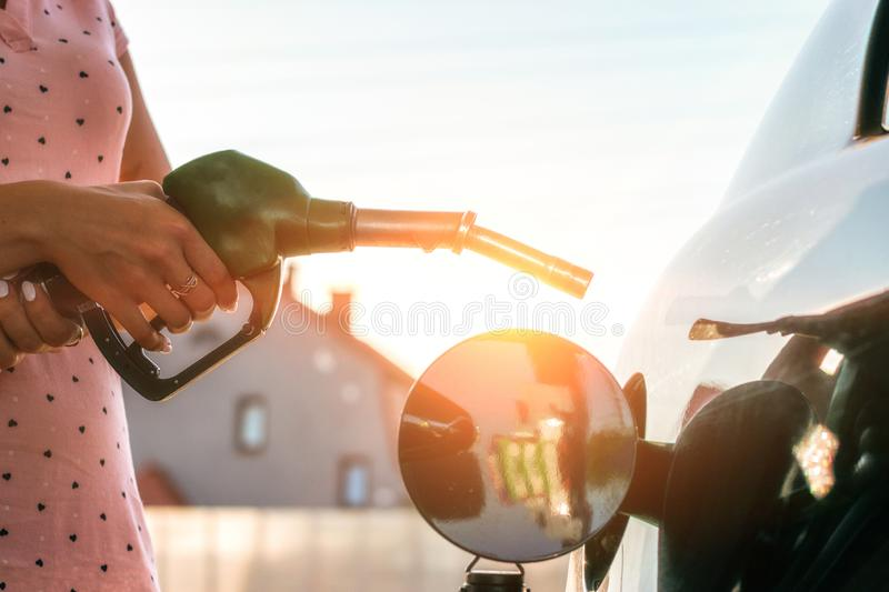 Transportation and ownership concept - woman pumping gasoline fuel in car at gas station royalty free stock photos