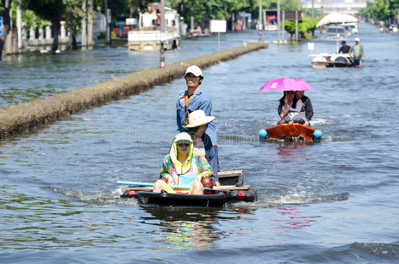 Transportation of people in the streets after floo. BANGKOK, THAILAND-NOVEMBER 13: Transportation of people in the streets flooded after the heaviest monsoon stock photography