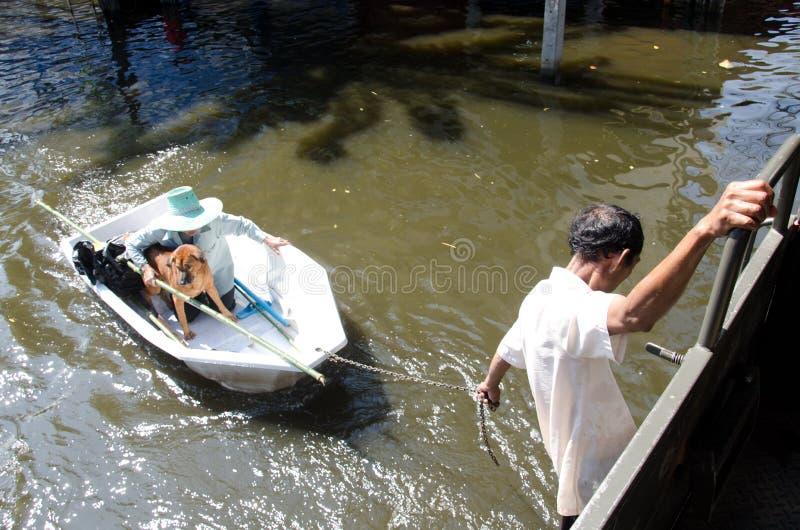 Transportation of people in the streets flooded. BANGKOK, THAILAND-NOVEMBER 13: Transportation of people in the streets flooded after the heaviest monsoon rain stock photos