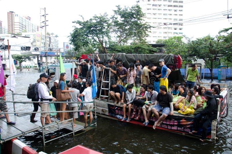 Transportation of people in the streets flooded. BANGKOK, THAILAND-NOVEMBER 13: Transportation of people in the streets flooded after the heaviest monsoon rain royalty free stock photo