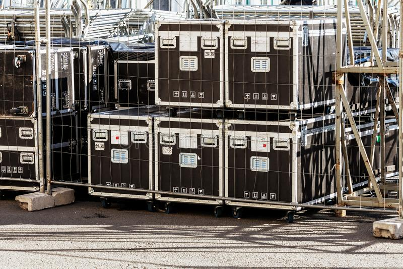 Transportation and storage of concert equipment. Containers and boxes with metal trim on wheels. Carrying crates royalty free stock photos