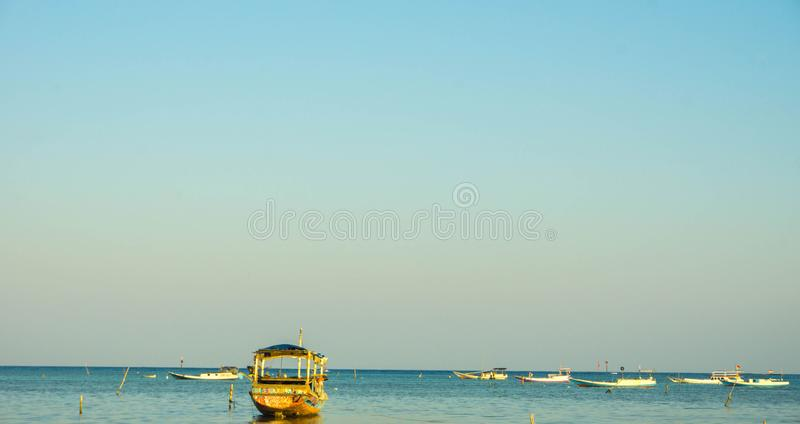 A transportation traditional boat on the tropical sea in karimun jawa stock images