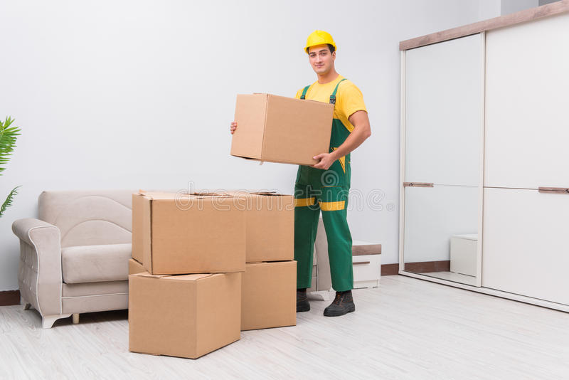 The transportation worker delivering boxes to house. Transportation worker delivering boxes to house stock photography