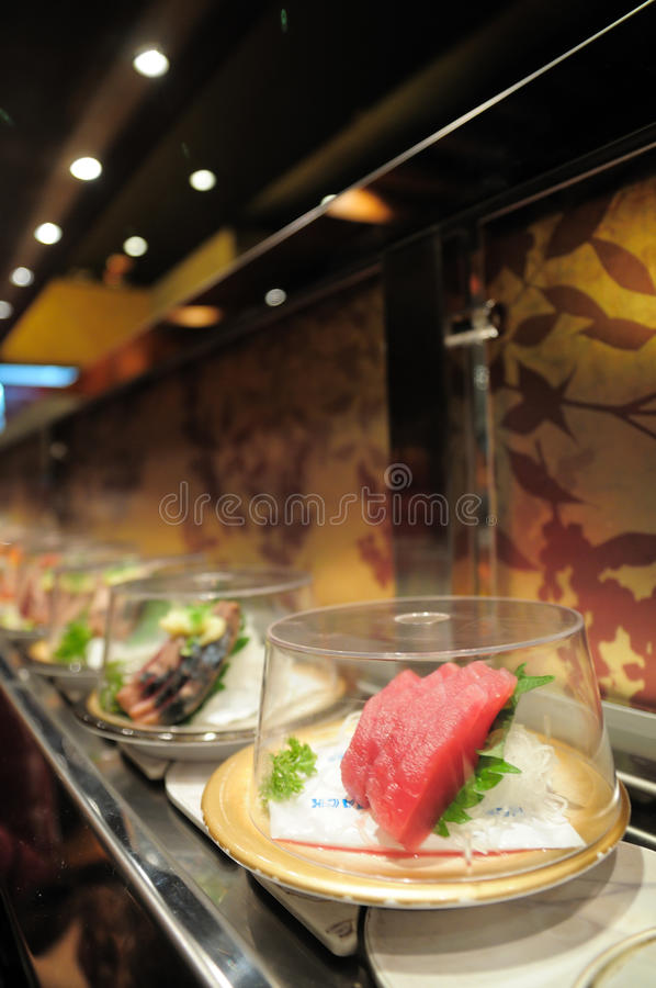 Transportbandsushi stock foto's