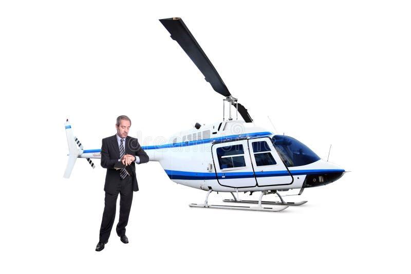 Transporte del helicóptero del hombre de negocios que espera para fotografía de archivo libre de regalías