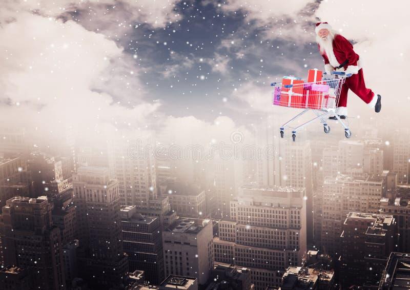 Transportierende Laufkatze Weihnachtsmanns voll von Weihnachtsgeschenken über der Stadt stockfotos