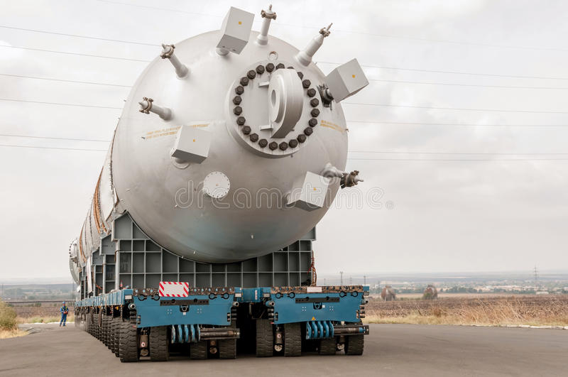 Transporting mega installation to refinery. Hydrocracking mega installation. Hydrocracking is a two-stage process combining catalytic cracking and hydrogenation royalty free stock photo