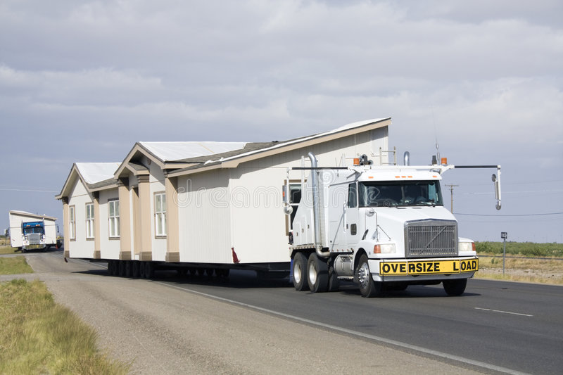 Transporting portable homes stock photos