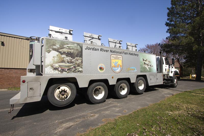 Transporting Trout For Sportfishing In Michigan. Brimley, Michigan, USA - May 5, 2016: US Fish and Wildlife semi truck preparing to transport fish from hatchery stock photography