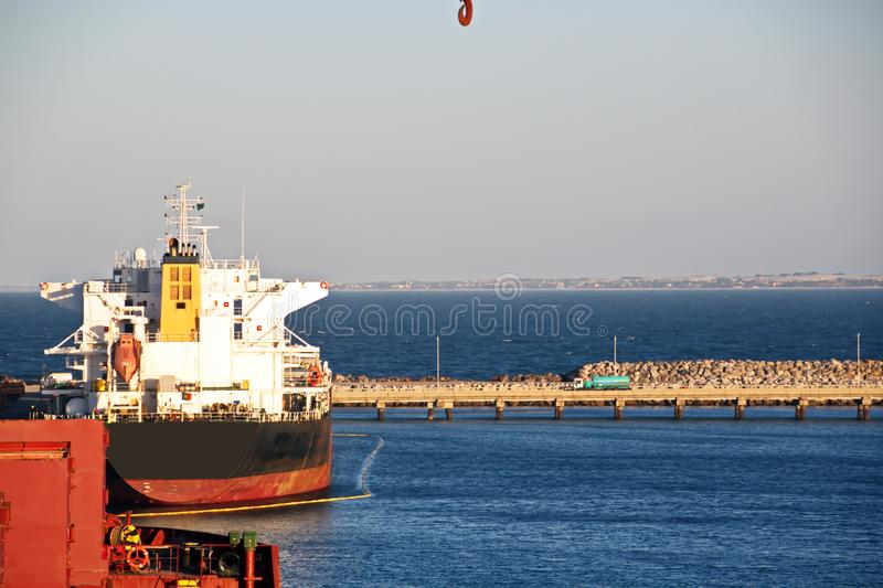 Transshipment terminal for loading steel products to sea vessels using shore cranes and special equipment in Port Pecem, Brazil,. Transshipment terminal for stock image