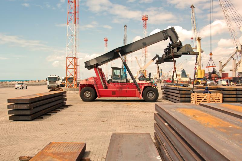 Transshipment terminal for loading steel products to sea vessels using shore cranes and special equipment in Port Pecem, Brazil,. Transshipment terminal for stock photo