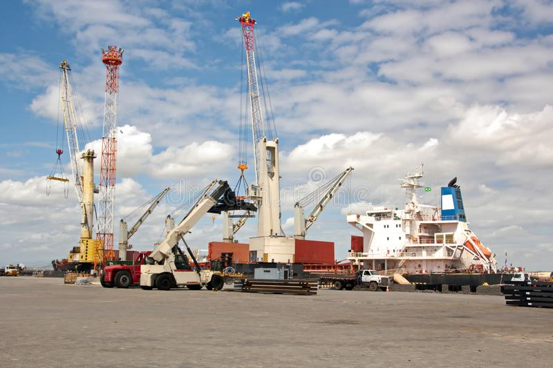 Transshipment terminal for loading steel products to sea vessels using shore cranes and special equipment in Port Pecem, Brazil,. Transshipment terminal for royalty free stock images