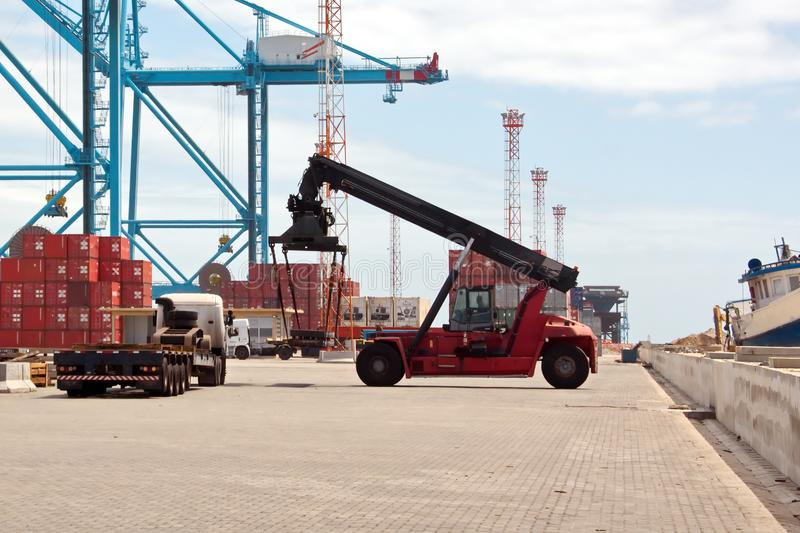 Transshipment terminal for loading steel products to sea vessels using shore cranes and special equipment in Port Pecem, Brazil,. Transshipment terminal for royalty free stock photos